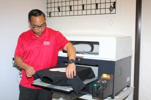 Custom T-Shirt printing on a direct-to-garment printer.